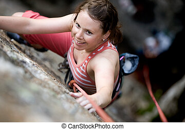 Female Climber - A female climber on a steep rock face...