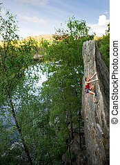 Female Rock Climber - An eager female climber on a steep...