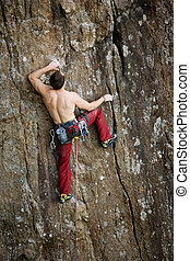 Male Rock Climber - A male climber against a large rock face...