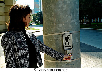 Woman in crosswalk - Atractive woman pressing crosswalk...