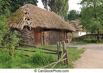old barn - old wicker shed with thatch roof on historical...