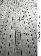 Nailed wooden flooring Gray knotty wooden planks
