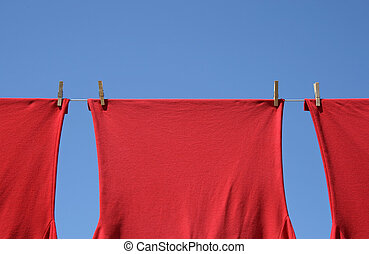 Red t-shirts on a clothes-line