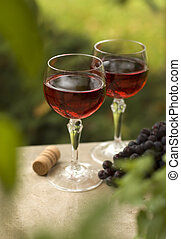 wine - red wine in glass with red grape close up