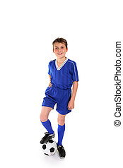 Soccer champ - Happy young boy dressed in soccer gear rests...