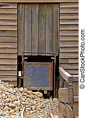 old mine cart - an old mine cart is blocked by rocks and...
