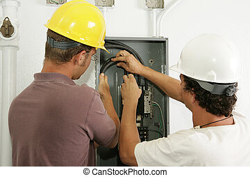 Electricians Install Panel - Electricians working together...