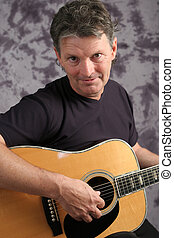 Sexy Musician - A portrait of a handsome middle aged...