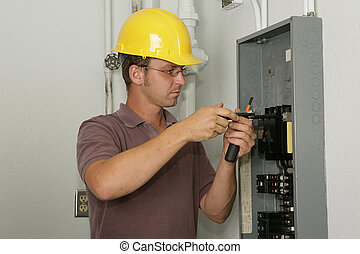 Electrician Industrial Panel - An electrician working on an...