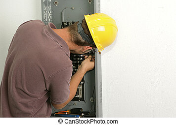 Electrician Connecting Wire - An electrician working on an...