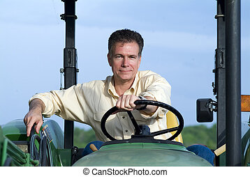 Farmer - Handsome mature white male sitting comfortably on a...
