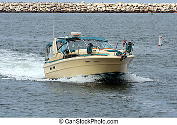 Motorboat entering Harbor Channel - motorboat cruising...