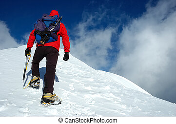 Mountaineer - A lonely climber reaching the summit of the...