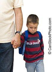 sad school boy - sad boy walking to school by his fathers...