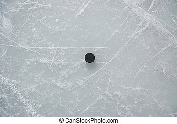 hockey puck  - Ice with hockey puck in the centre.