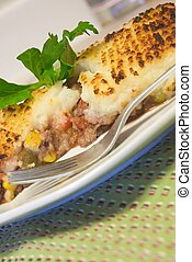 Shepherds pie - minced ground meat topped with parsley...