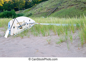 Sailboat on Lake Michigan Beach - A sailboat on its side on...