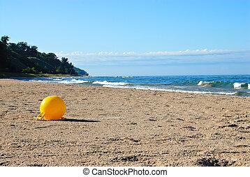 Lake Michigan - A bouy drifted ashore on the beach of Lake...