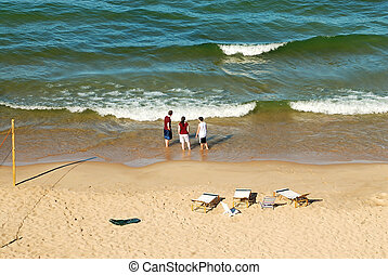 Lake Michigan Beach in the Summer - a family playing on the...