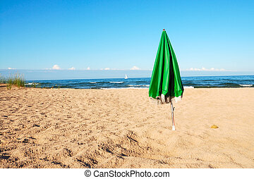 Umbrella On A Deserted Beach - Lake Michigan beach on a...