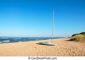 Lake Michigan Sailboat - A sailboat on the beach at Lake...
