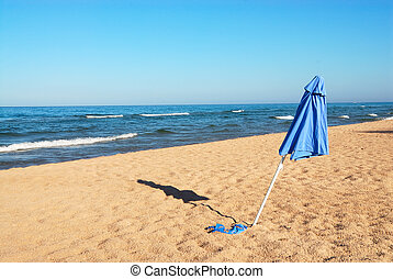 Umbrella in the Sand at Lake Michigan, USA - A beach...