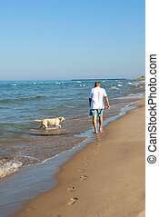 Walking the Dog, Lake Michigan USA - A man walking his dog...