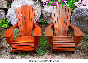 Patio chairs - Two solid wood patio chairs and natural stone...