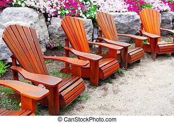 Patio chairs - Row of solid wood patio chairs and natural...