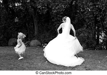 Twirling - Playful bride twirling her dress with the flower...