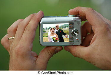 wedding day - bride and groom in a guest camera