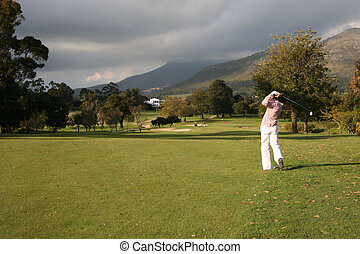 Golf - Young golfer playing a round of golf on a South...