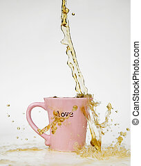 Coffee Splash Love Mug - Coffee splashes over the rim of a...