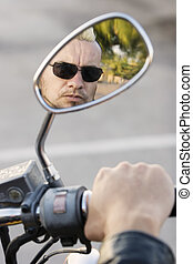 Punk in Motorcycle Rearview Mirror - Man with a punk haircut...