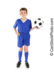 Soccer game - Boy standing with hand on hip and holding a...