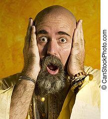 Funny Guru - Funny bald guru with a long beaded beard.