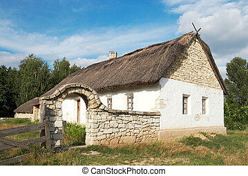 farmstead - historical country farmstead with stone fence...