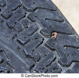 Tire with a nail