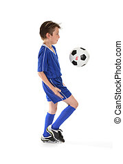 Soccer moves - A boy in training, practices some soccer...