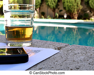 Drink, mail and phone by the pool