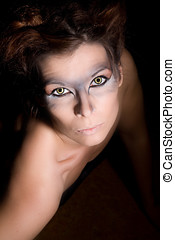 Werewolf looking up - Beautiful woman with wolf eyes looking...