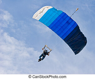 Skydiver - parachutist floating on the wind