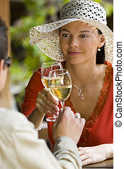 Romantic Drink - A beautiful dark haired woman beautifully...
