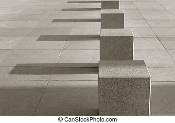 Solid order - Stone cubes on the sidewalk