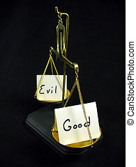 Good vs evil - Good and evil cards on a gold scale