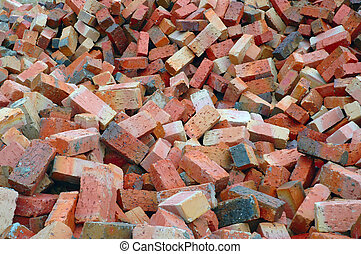 Red Construction Bricks - A heap of red soil construction...
