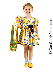 Little smiling girl with shopping bag. Isolate on white...