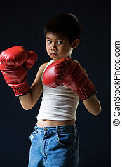 Little boy boxer - Young asian boy with serious expression...