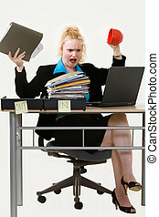 Frustration - Blond business woman sitting at desk in the...