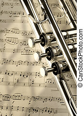 notes - Trumpet on musical notes as background close up